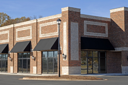 Facade of a New Commercial Building with Retail and Office Space for Lease